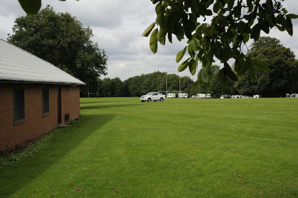 Travellers driving across playing fields