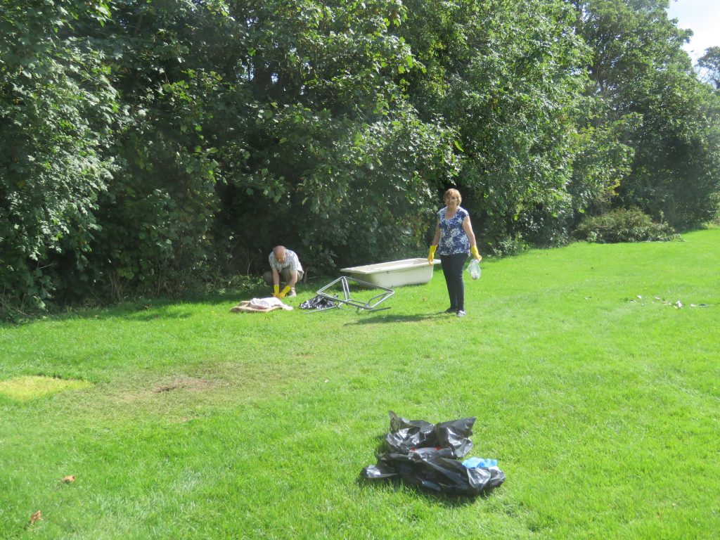 Trustees picking up rubbish left by the Trustees
